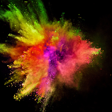 Colored powder explosion on black background. Freeze motion.